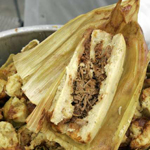 Single Beef Tamale. Opened to see meat inside tamale
